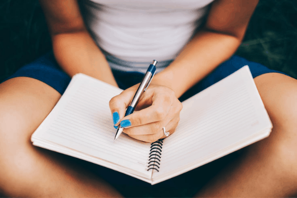 girl sitting with journal