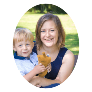 Christian blogger Emily Davies holding young son